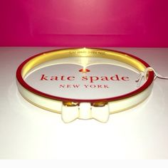 Kate spade white bow bangle New with tags! Take a bow bangle by kate spade. Shiny gold metal and enamel fill. Makes a great Christmas gift! Dust Bag included. Price is firm. kate spade Jewelry Bracelets