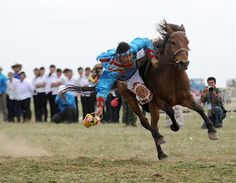 One for intrepid souls who thirst for sporting exotica, it's the annual five-day festival in the city of Batou, showcasing equine skills, wrestling and other traditional Mongolian pursuits, taking place in August. Nadam, which means ''entertainment and games'' in Mongolian, has a tradition of more than 700 years.