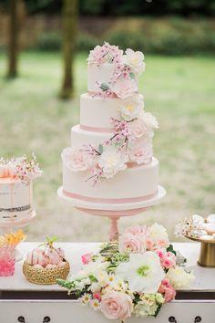 cherry blossom wedding cake - photo by Elisabeth van Lent Photography http://ruffledblog.com/cherry-blossom-garden-wedding-ideas