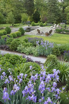 Garden with underlying structure of boxwood hedings & pyramids | Perennial garden | Stone wall | 2015 APLD International Landscape Design Award