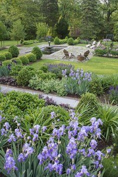 Garden with underlying structure of boxwood hedings & pyramids | Perennial garden | Stone wall | 2015 APLD International Landscape Design Award