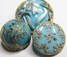 Antique Victorian Glass Flowered buttons in a pretty aqua colour.