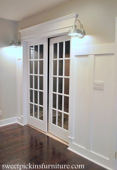 Add crown moulding to doorframe and wainscoat to wall to generate a different look...