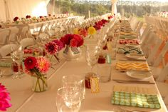 Love this wedding table setting with mixture of vases , colorful flowers & unique napkins.