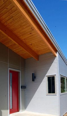 For aesthetics, durability and ability to recycle, Skiles Architect and the Allens chose exterior cladding of fiber cement board (FCB) an. Exterior Wall Materials, Butterfly Roof, Aluminium Cladding, Simple Shed, Metal Siding, Exterior Cladding, Roof Panels, Timber House, Metal Homes