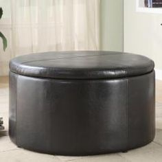 @Overstock - This round storage cocktail table features dark brown vinyl upholstery with baseball stitching accents. The top of this unit opens to reveal nesting teardrop ottomans that can be removed for additional seating needs.http://www.overstock.com/Home-Garden/Harper-Dark-Brown-Cocktail-Table-with-Kidney-Ottomans/5943177/product.html?CID=214117 $279.99
