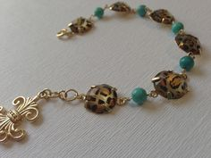 One Of a Kind Accessories!   Leopard, Teal, and Gold Bracelet. $14.50, via Etsy.