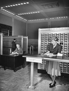 A man and a woman looking up books through the card catalogue at the Congressional Library, 1941.