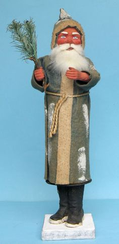 Santa candy container with composition face and hands with feather tree branch, black boots attached to the container, coat originally blue. German.