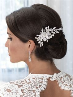 Crystal & Rhinestone Floral Comb features sparkling rhinestone encrusted leaves in a beautiful floral pattern.