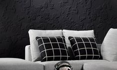 Eclipse, an exquisite three-dimensional textile wallcovering on non-woven backing in black & white.