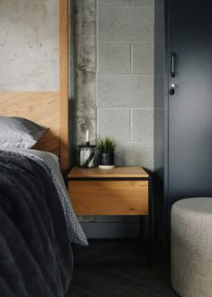 The oak Monolit bedside table and the oak Kelham bed - all from Natural Bed Company.