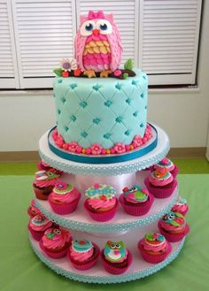 I don't like the owl necessarily, but the cake tower with the cake on top and cupcakes surrounding the bottom levels is a great idea! I might try that for my daughters party :)