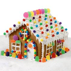 Multi-colored candies and creative icing decorations make this cottage a project that everyone can't wait to finish. Colorful window trims and walkways lined w… Gingerbread Christmas Decor, Gingerbread House Designs, Candy Land Christmas, Gingerbread House Parties, Christmas Baking, Gingerbread Cookies, Christmas Cookies, Gingerbread Houses, Family Christmas