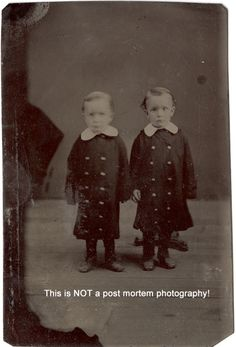 "I have seen this tintype from my collection posted on Pinterest as a post mortem. Why? Because the twin on the right has the base of a posing stand behind him. I have often seen a comment ""If he wasn't dead why would he need to be held up by a stand?"" One of the reasons I bought his tintype was because it illustrates so well the reason for head brace. The twin on the left has no head stand and he is slightly blurred because he moved his head."