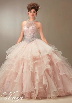 Mori Lee Vizcaya Quinceanera Dress Style 89074 is made for girls who want to look like a beautiful Princess on her Sweet 15. Made out of tulle, this ball gown features a sleeveless bodice with a sheer
