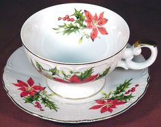 Poinsettia & Holly embossed dainty teacup and saucer by Inarco, Japan.