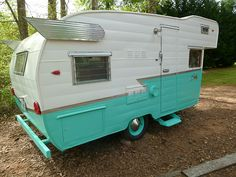 '65 Shasta Astroflyte trailer. click to site to see the awesome retro renovation the owners did on the interior!