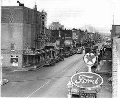 Up on the roof of the old Ford Dealership next to the old Texaco station on Tower Ave. Look at the corner business thats there, know whats there now?