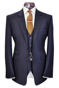 A one button single breasted double vented suit, peak lapel with the  addition of a 5 button v-shaped waistcoat.