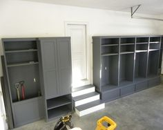 Garage mudroom made from bookcases on top of storage benches; add hooks for jackets & bags.
