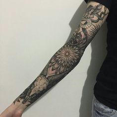 Arm tattoo mandala skull snake