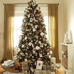 Put old cards and assorted baubles to good use as decor. Make sure your tree doesn't look too busy by sticking to a certain theme or color palette -- like silhouettes, black, white, and gold on this tree./