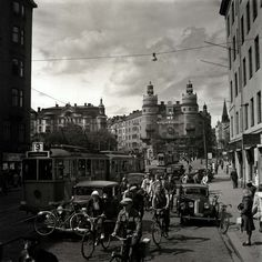Stockholm, c.1940s, by K W Gullers. Lots of different kinds of traffic!