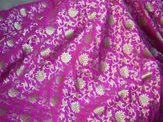 This is a beautiful pure benarse silk brocade floral motifs design fabric in Magenta and Gold. The fabric illustrate small golden woven motifs on black background.  You can use this fabric to...