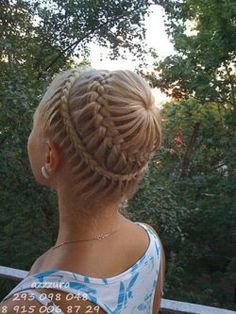 trying to figure this one out.... maybe a dutch lace pancake braid, followed by dutch french pancake braid from a ponytail? either way, you need really long hair.............