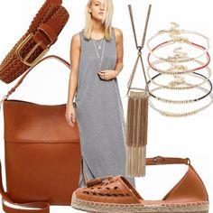 Sportiva con l'abito grigio, lungo in maglina. Abbinata ai giusti accessori però può diventare country. Sandalo, borsa e cintura in vita rigorosamente in color cuoio. Collana a contrasto in color oro e braccialetti in corda e oro.