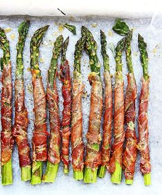 Grilled asparagus wrapped in crispy prosciutto and sage. Scatter with ...
