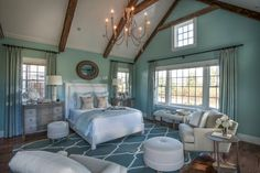 HGTV.com showcases the relaxing master bedroom from HGTV Dream Home 2015, which features a calming blue color palette, warm fireplace and private patio.