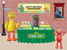 Party planning site. Like the solid green table cloth with basic Sesame Street sign in front.