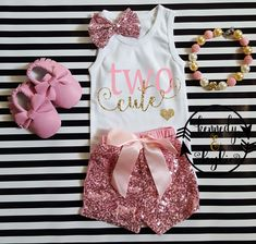 Pink and Gold Two Cute Shirt With Pink Sequin ShortsLet us add a little or a lot of shine to your little sweetie's life with our NEW! trendy pink and gold Two Cute birthday outfit for two year old birthday celebrations. This outfit is so cute and perfect for your little angel's birthday celebration, photo shots or every day wear. The top is Made with a glitter gold that wont come off and paired with pink sequin shorts with a pink satin bow. The back of the shorts are made of pink cott...