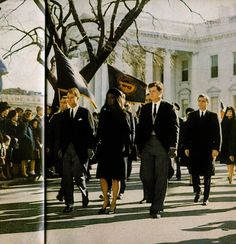 11/25/63: Jacqueline Kennedy leads the funeral procession off the White House grounds, headed to St. Matthew's Cathedral.