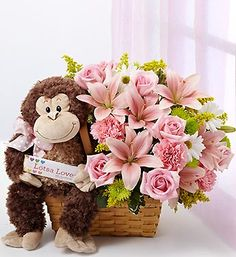 This gorgeous basket arrangement of lilies, roses, carnations, daisy poms is a great congratulation to the new mom!  We also include our adorable plush monkey for baby to cuddle!