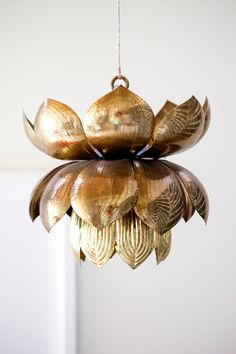 in love with this vintage tommi parzinger brass lotus pendant