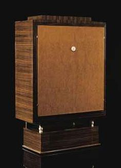 'DUVAL', A MACASSAR EBONY, BURR AMBOYNA AND BURR ASH VENEERED AND IVORY CABINET BY ÉMILE-JACQUES RUHLMANN, DESIGNED IN 1924