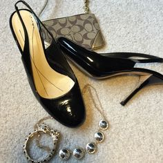 Kate Spade black patent leather pumps Classic and classy! These beautiful pumps have a slight platform and a slender heel. Very good condition with only a slight nick at the base of one heel and a few faint scuffs. kate spade Shoes Heels