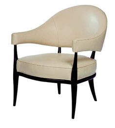 Get the Look: A Chicago Greystone Gets a Colorful Modern Update - Barrel back arm chair with rounded, shaped legs extending from the bottom of the arms and back to the floor. Tight seat cushion is framed with exposed wood base. Shown in leather upholstery. By Michael Berman Ltd.