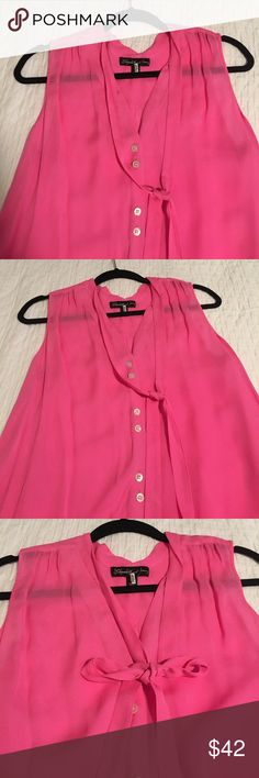 Elizabeth and James Pink Silk Top 100% Silk Elizabeth and James top was purchased at Neiman Marcus. It is a hot pink and has a tie, seen pictured with a knot and a bow! Excellent condition, worn once. Size tag is missing. Elizabeth and James Tops Blouses