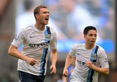Dzeko sends 100-goal City to brink of title