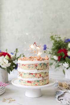 Momofuku Milk Bar's birthday cake has been transformed into the perfect of July Cake! It has three delicious vanilla flavors and a creamy frosting - cake cheesecake cake cupcakes cake decoration cake fancy dessert cake 4th Of July Cake, 4th Of July Desserts, 4th Of July Party, Momofuku Cake, Momofuku Milk Bar, Slow Cooker Desserts, Pretty Cakes, Beautiful Cakes, Desserts