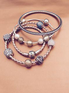 Stack different PANDORA bracelets for a festive and stylish New Year's look. #PANDORAbracelet #PANDORAessencecollection