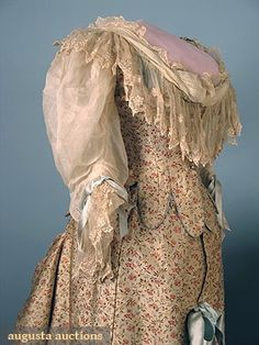 2 SILK TRAINED BUSTLE GOWNS, 1880s Both 2-piece: 1 small patterned floral brocade reception gown; 1 1888 cream silk faille wedding gown w/ embroidered silk lace