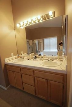 Before and after of bathroom vanity makeover by the for Updating bathroom ideas