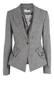 Tailored jackets with a v-neckline are a must for apple-shaped women to create a slimming waist. :).  Stay away from double breasted jackets, wide lapels, and any type of padding.