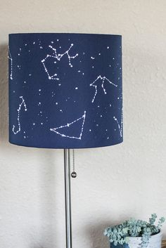 DIY Constellation Lamp. Poke holes to make the room a starry night.