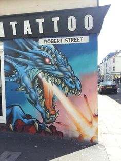 Brighton street art | graffiti: Dragon in Robert Street
